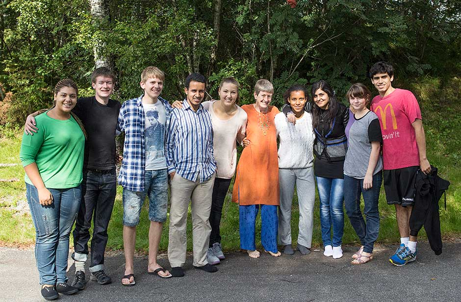 One of the advisors with her group of advisees. They are all smiling because they just had cake!
