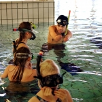 An RCN student leading a group of learners in the Haugland swimming pool