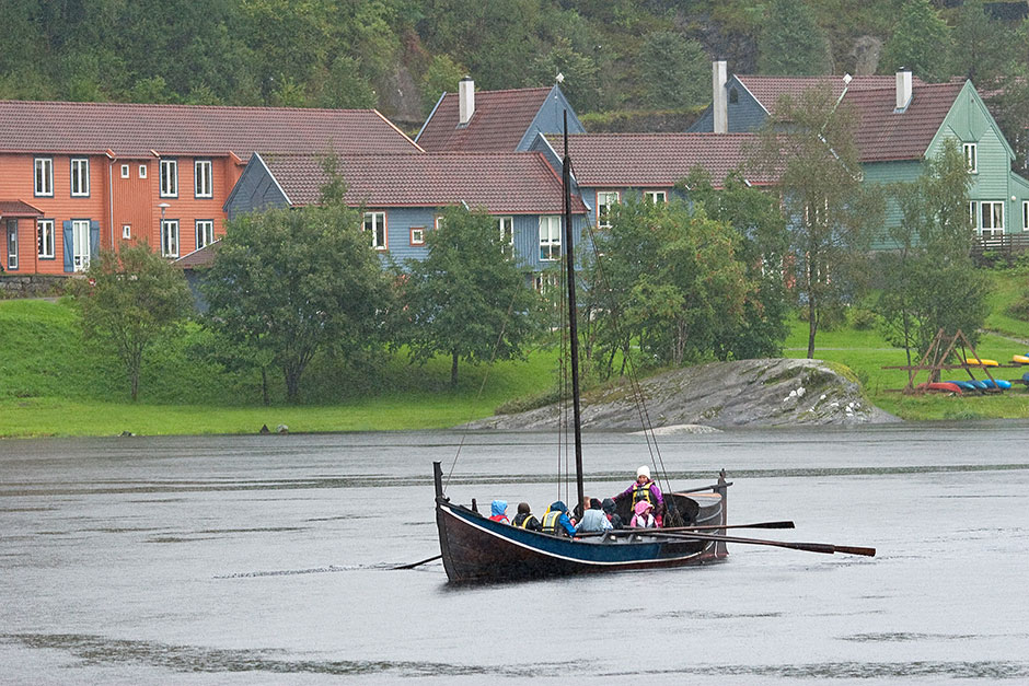 A traditional west coast boat. Here used by leirskule. The student village is behind