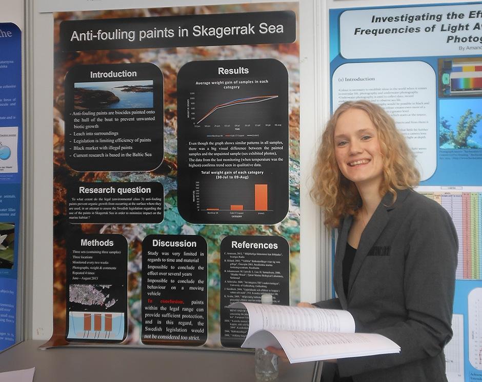 Maja Svanberg in front of her presentation