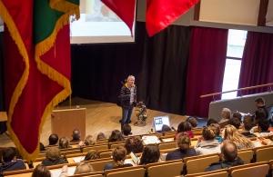 Cato speaking in the auditorium