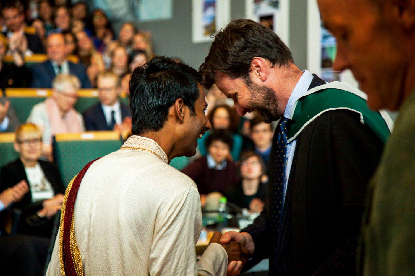 Receiving the Diploma during the ceremony